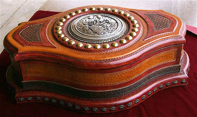 Artisan box covered in tooled leather and sterling silver accents by Richard Stump