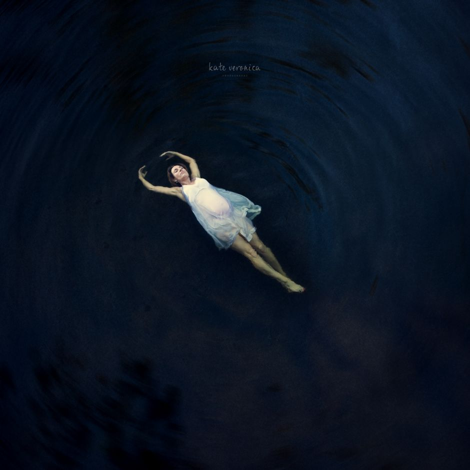Fine Art Maternity Portrait - Brisbane. Pregnancy woman floating in water. Kate Veronica Photography.