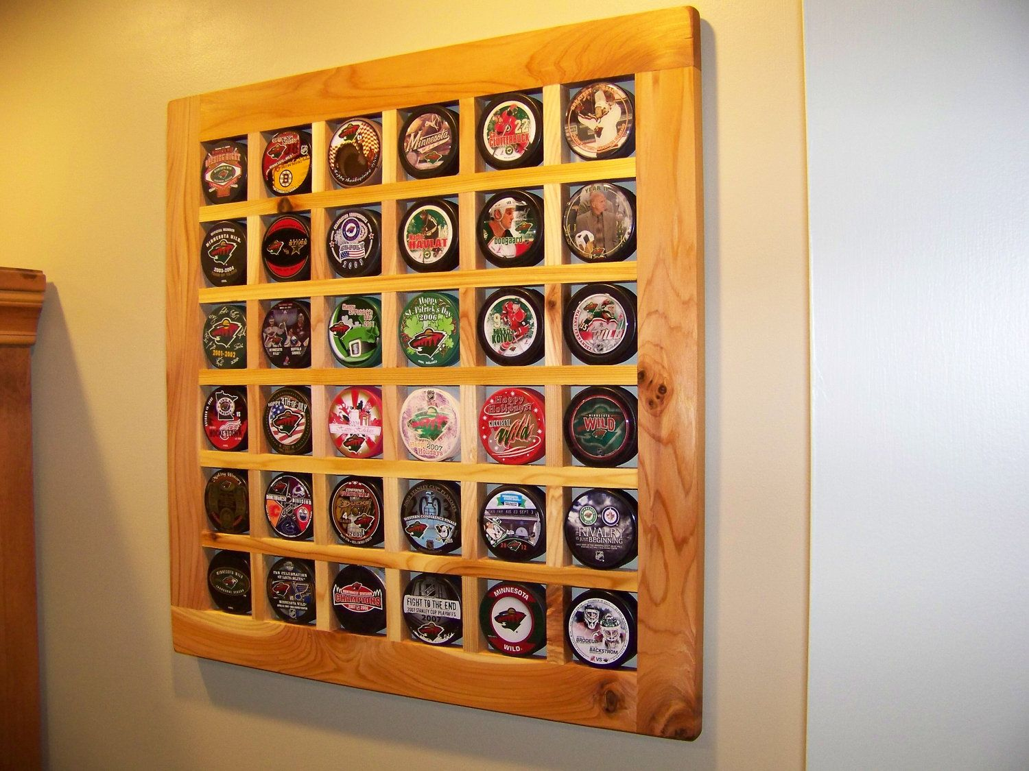 Hand Made (Cedar) Hockey Puck Display case / Holder.  Holds 30 pucks. $55.00, via Etsy.
