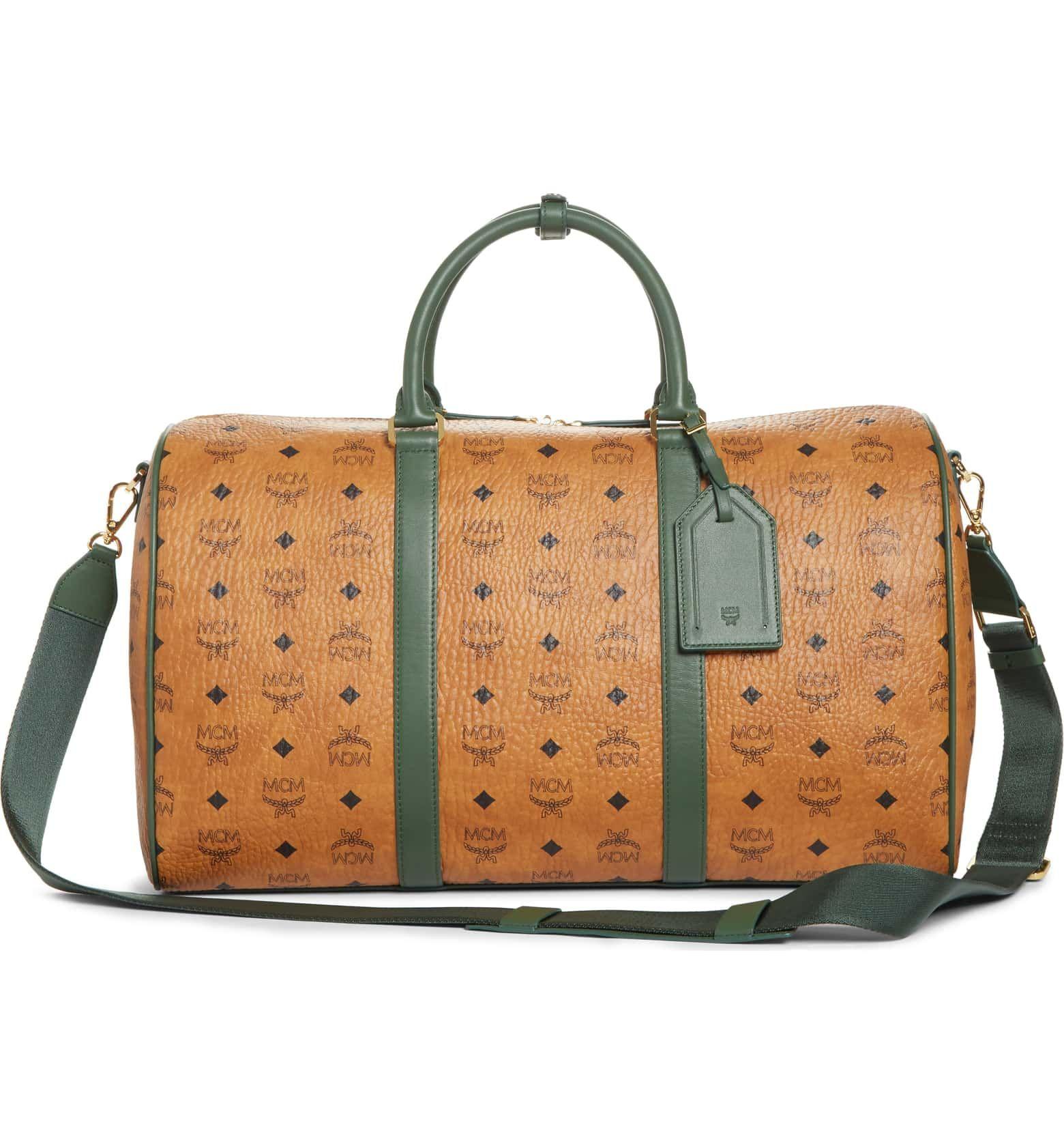 2efb5e710 #MCM Visetos Weekend Medium Bag in cognac and safari green | Patterned in  MCM's signature Visetos print, this striking duffel is cut with a sleek, ...