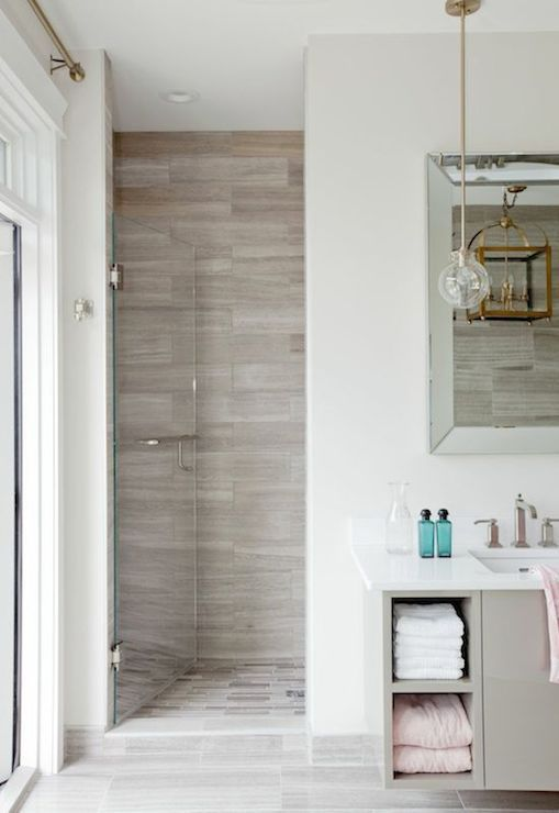 Stunning bathroom with gray stone tiled walk-in shower finished with ...