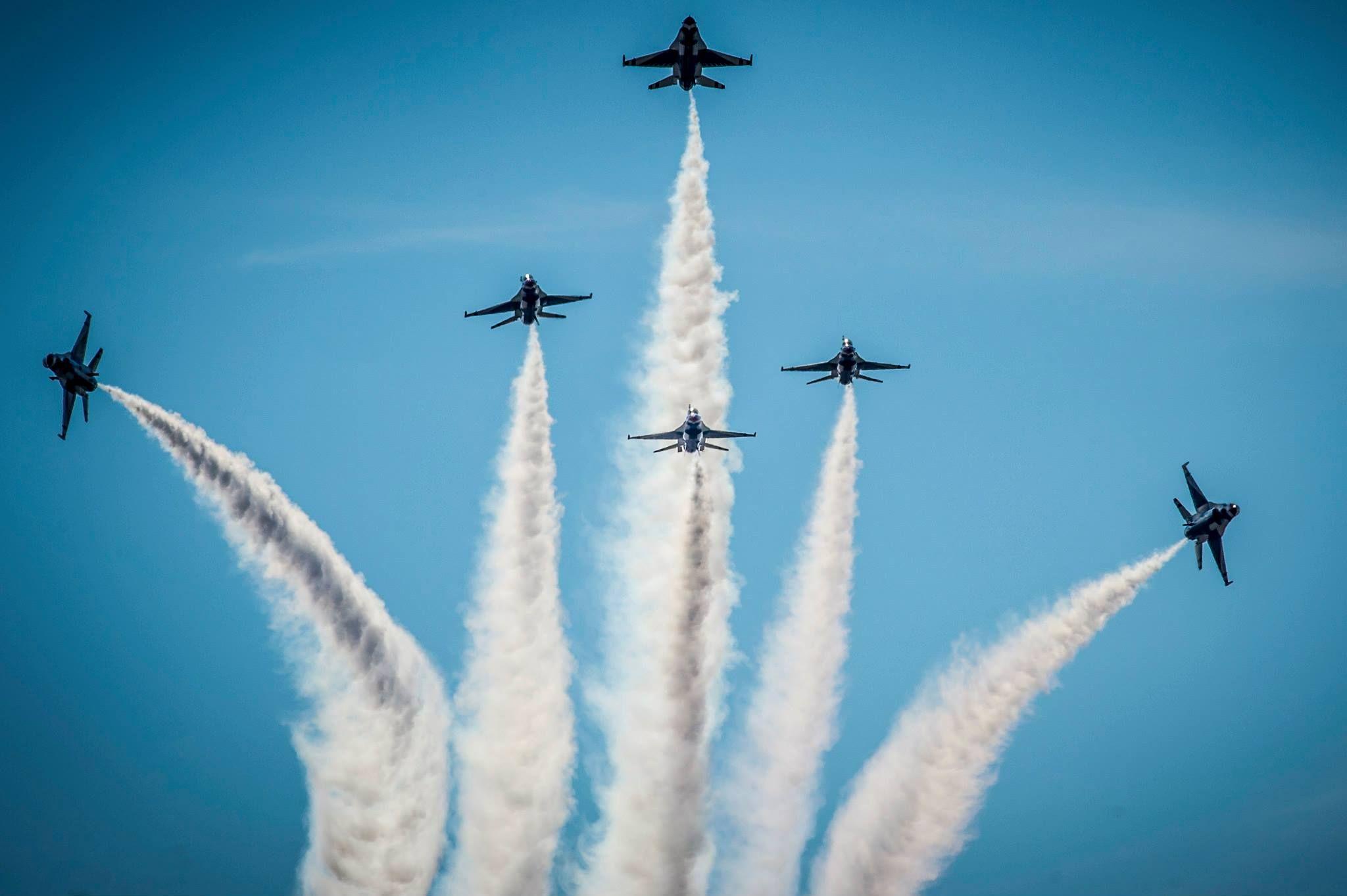 Thunderbirds pilots perform the Delta Burst maneuver