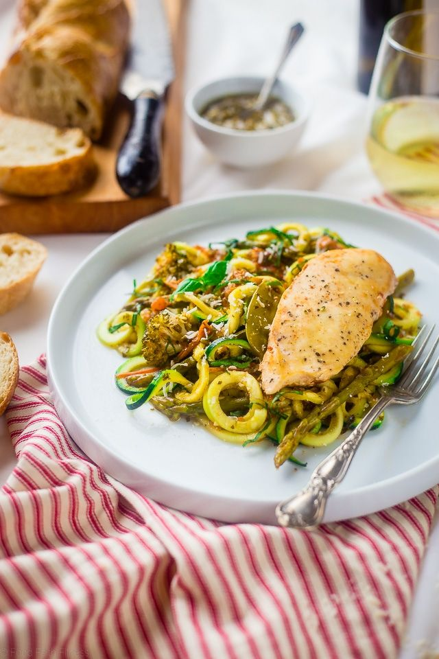 This easy Italian chicken is made in the slow cooker and is served over zucchini noodles for a light and healthy, gluten free dinner for under 350 calories!