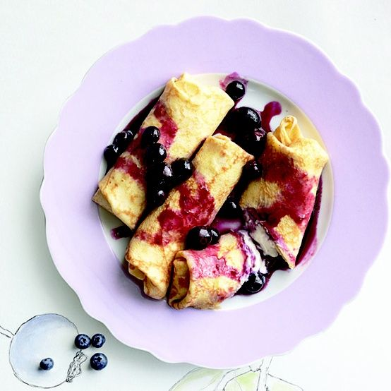Blueberry and cheese blintzes stuffed with a cottage cheese and honey-yogurt filling