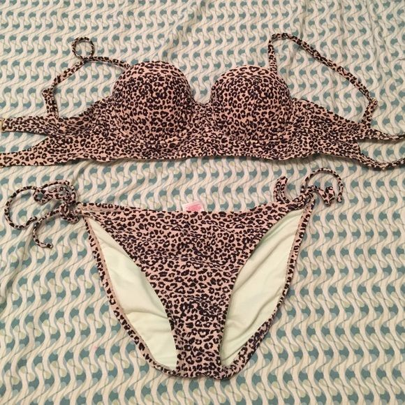 Cheetah Bikini! Cute Cheetah Bikini! Top and bottoms! Perfect for summer right around the corner! In great condition! Hardly ever worn! Medium in the top and large in the bottoms! Swim Bikinis