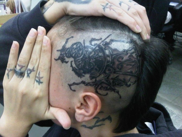 Biomechanics and Steampunk tattoo on the head