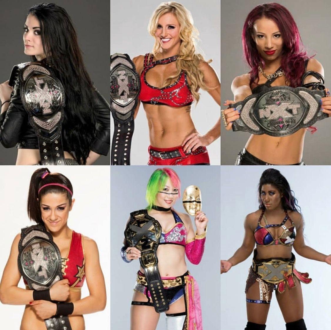 Nxt Women S Champions Paige Charlotte Sasha Banks Bayley And Ember Moon Wwe Girls Wwe Womens Wwe Female Wrestlers