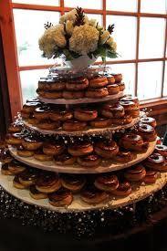donut wedding cake haha kinda funbut NOT in place of cake lol