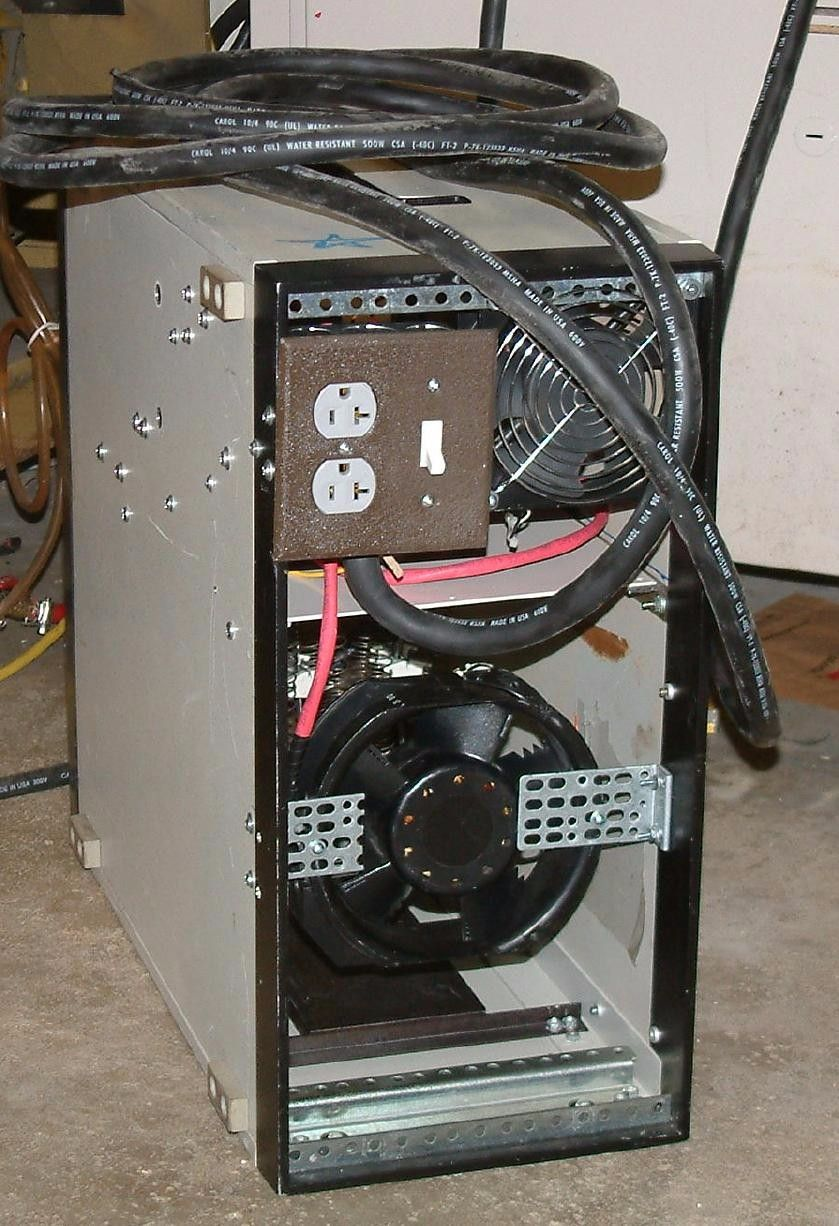 Homemade garage heater constructed from a 230 CFM fan, heating elements, and electrical hardware.