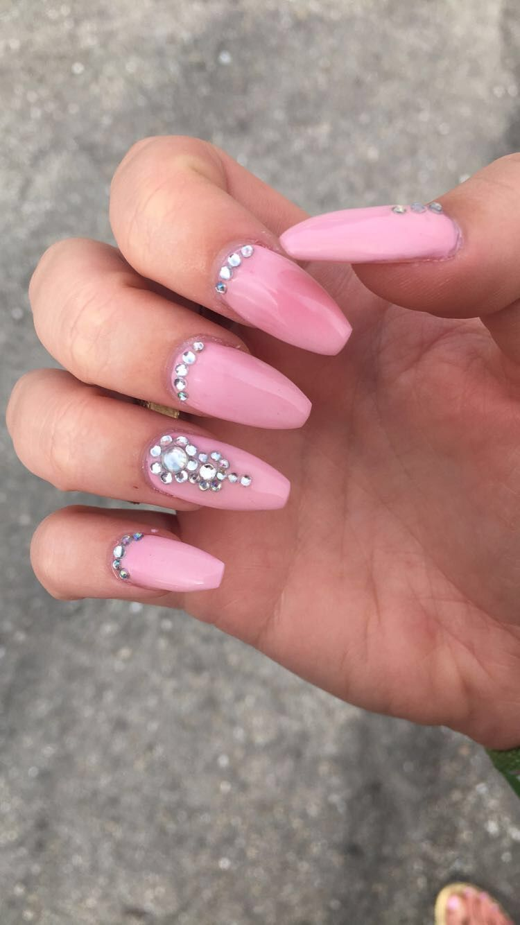 Light pink long coffin nails with crystal design