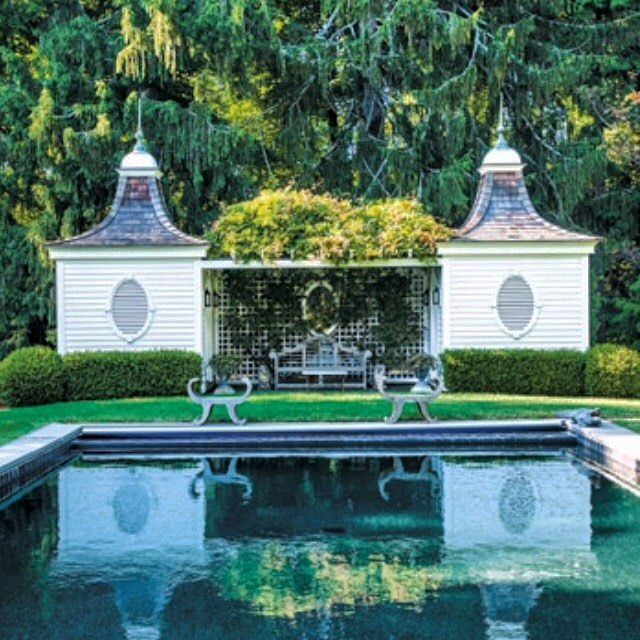 If you want reflective water in your garden it works best the darker the colour. Here Phil and Robin Schonberger, the owners of this Old Lyme property, painted the pool black which not only makes the water warmer but it gives the best reflection. The twin French inspired pool rooms framed by boxwood hedge and centered by a Lutyens bench reflect beautifully in the mirrored surface. Kindra Clineff #americangarden #poolroom #gardenroom #outdoorinspiration #gardensofinstagram…