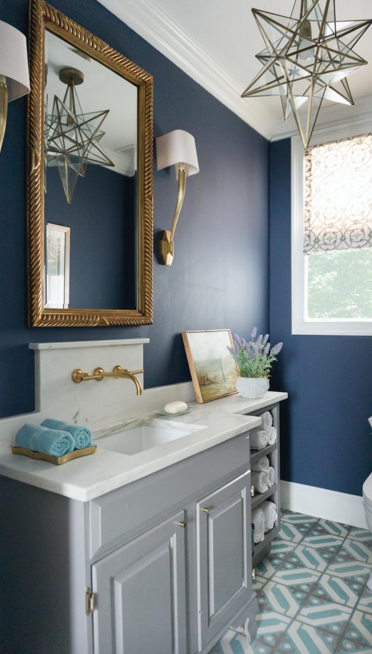 An Eclectic Powder Room With Hand Painted Cement Tile Floor Dark Blue Walls And A Custom Gray V Small Bathroom Decor Blue Bathroom Walls Grey Bathroom Vanity