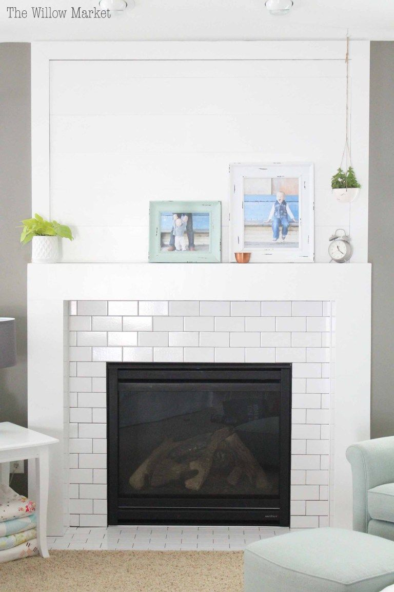 A New Fireplace With Shiplap And White Subway Tile Fireplace Tile Surround Subway Tile Fireplace Fireplace Tile