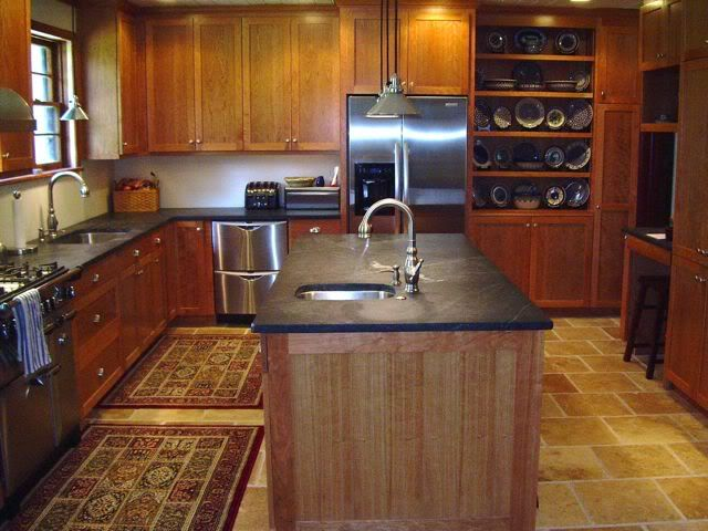 Natural Cherry Kitchen Cabinets With Soapstone Counters.