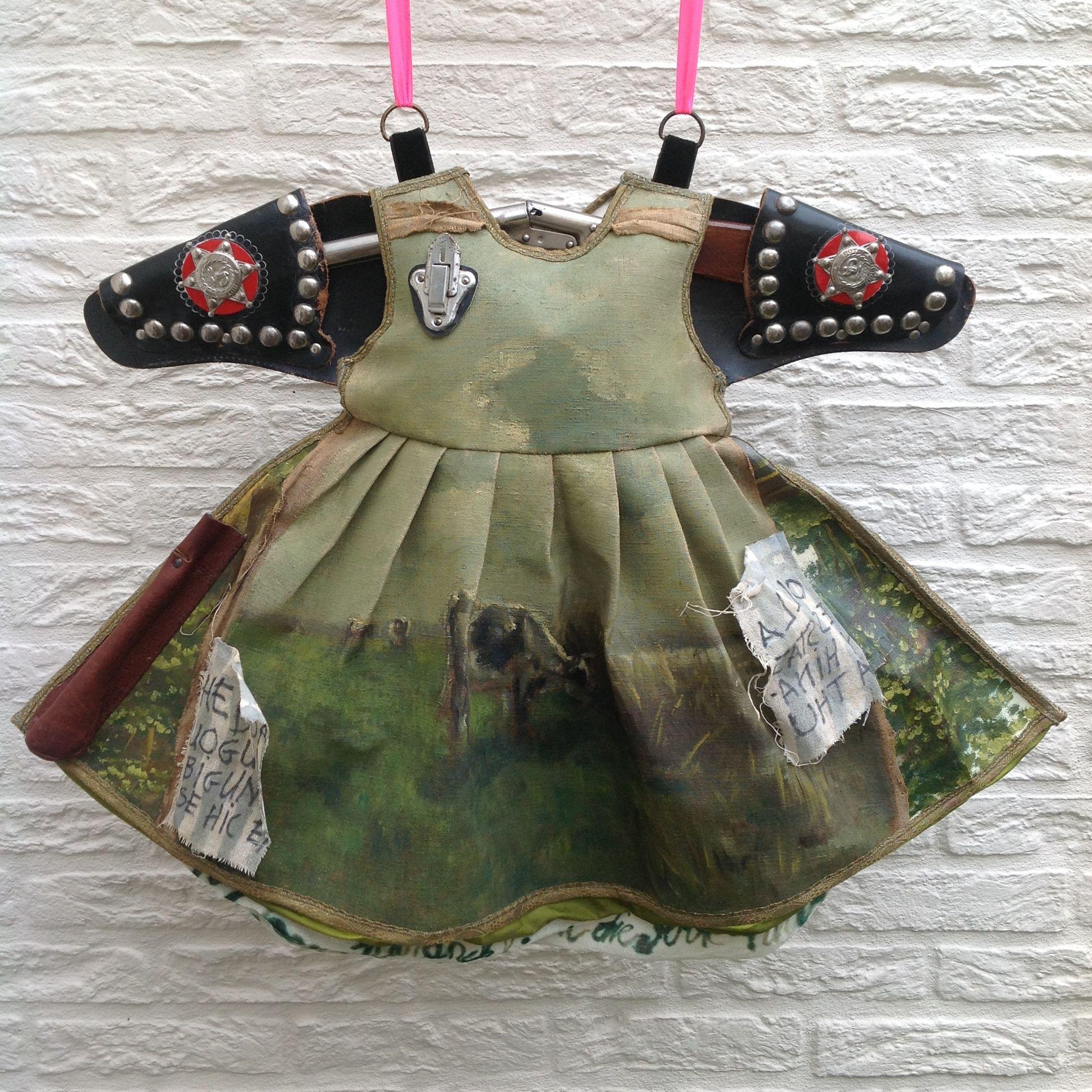 Dress made of old painting - vintage belt - gun . Karin van der Linden