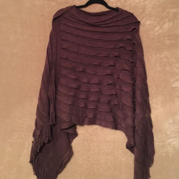 Brown pauncho Sweater pull over shawl. Sort of asymmetrical and very cute with tall boots, jeans and neck scarf. Fall will be here before you know it. Sweaters Shrugs & Ponchos