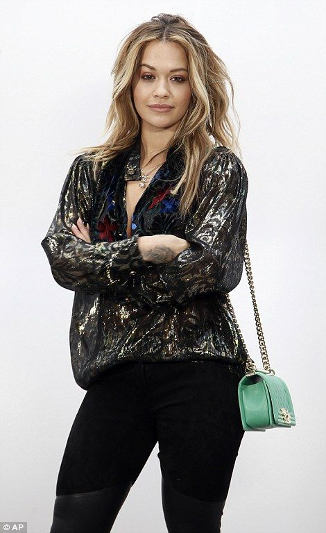 All in the details: Rita flashed a hint of skin in a plunging metallic top which had a ve...