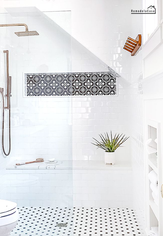 Modern farmhouse walk-in shower with subway tile, hex tile and Moroccan black and white decor tiles in niche