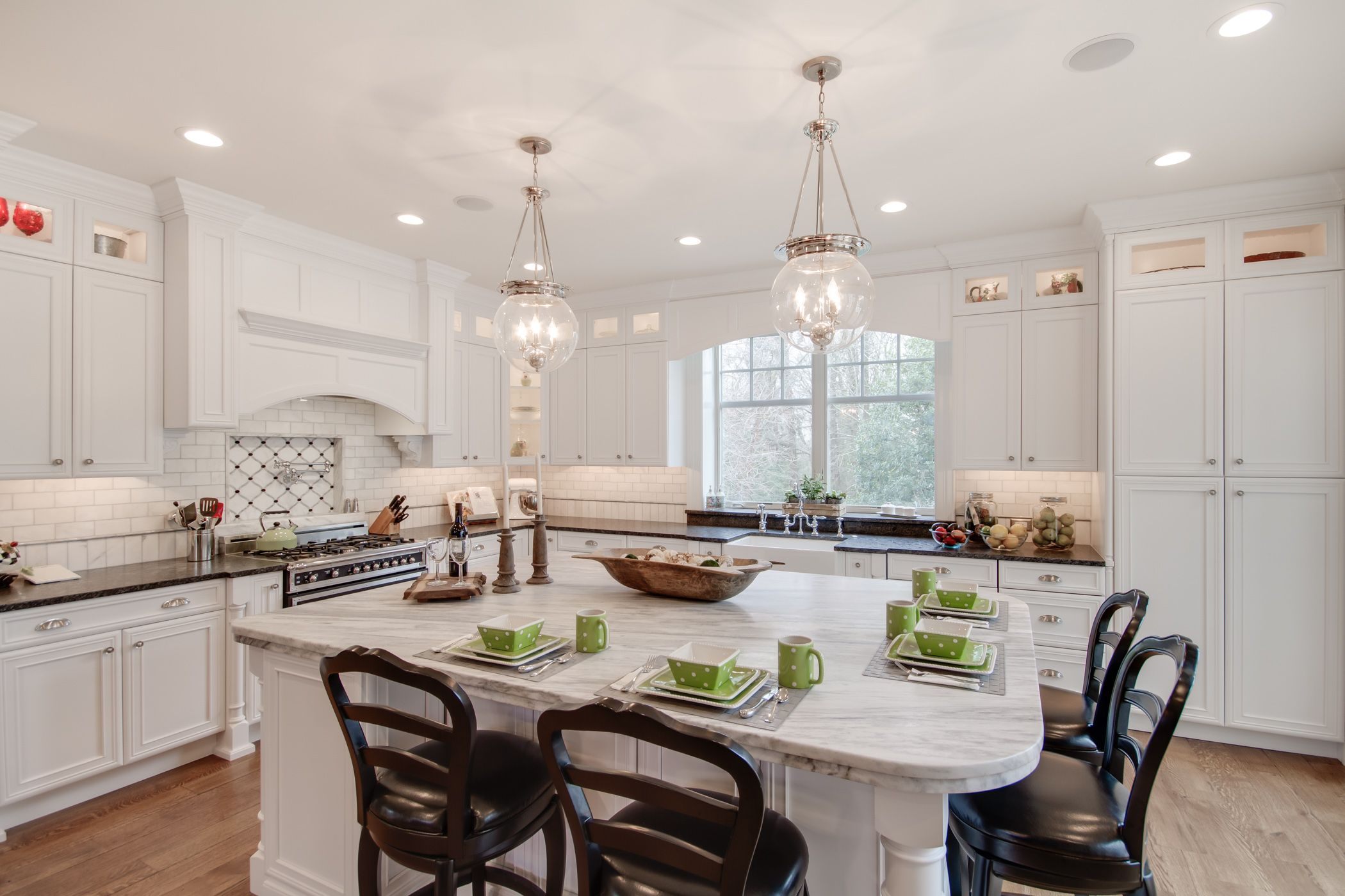 This Bright White Kitchen Features A Mont Blanc Honed Quartzite Island Countertop With A Silver Pearl Leathered Kitchen Remodel Countertops Kitchen Countertops