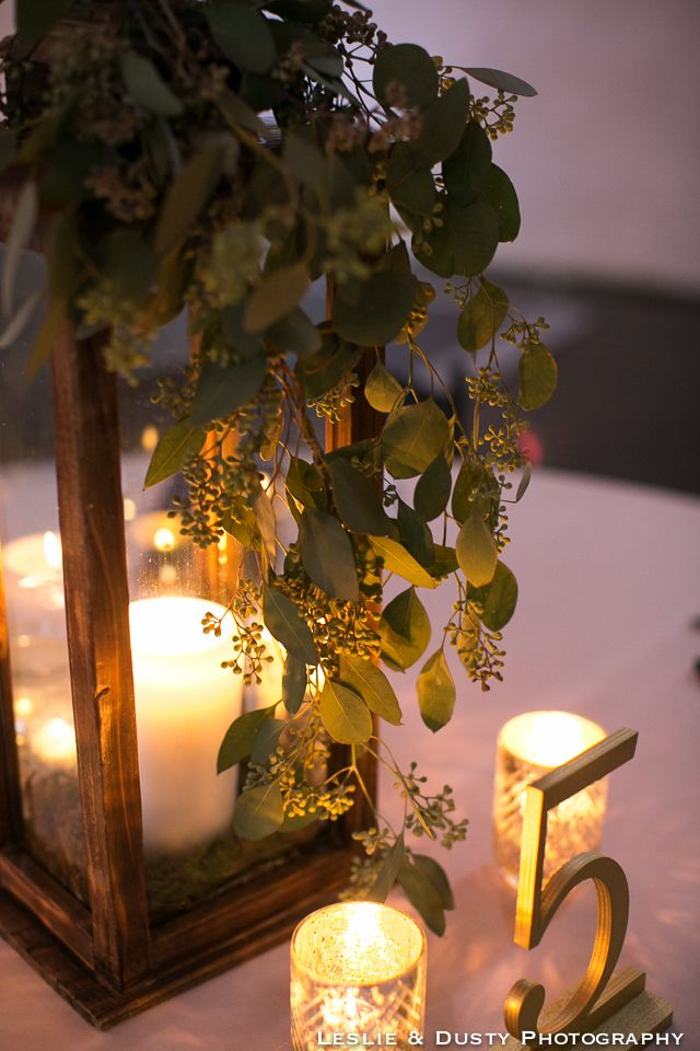 Centerpiece lantern with seeded eucalyptus mercury votive