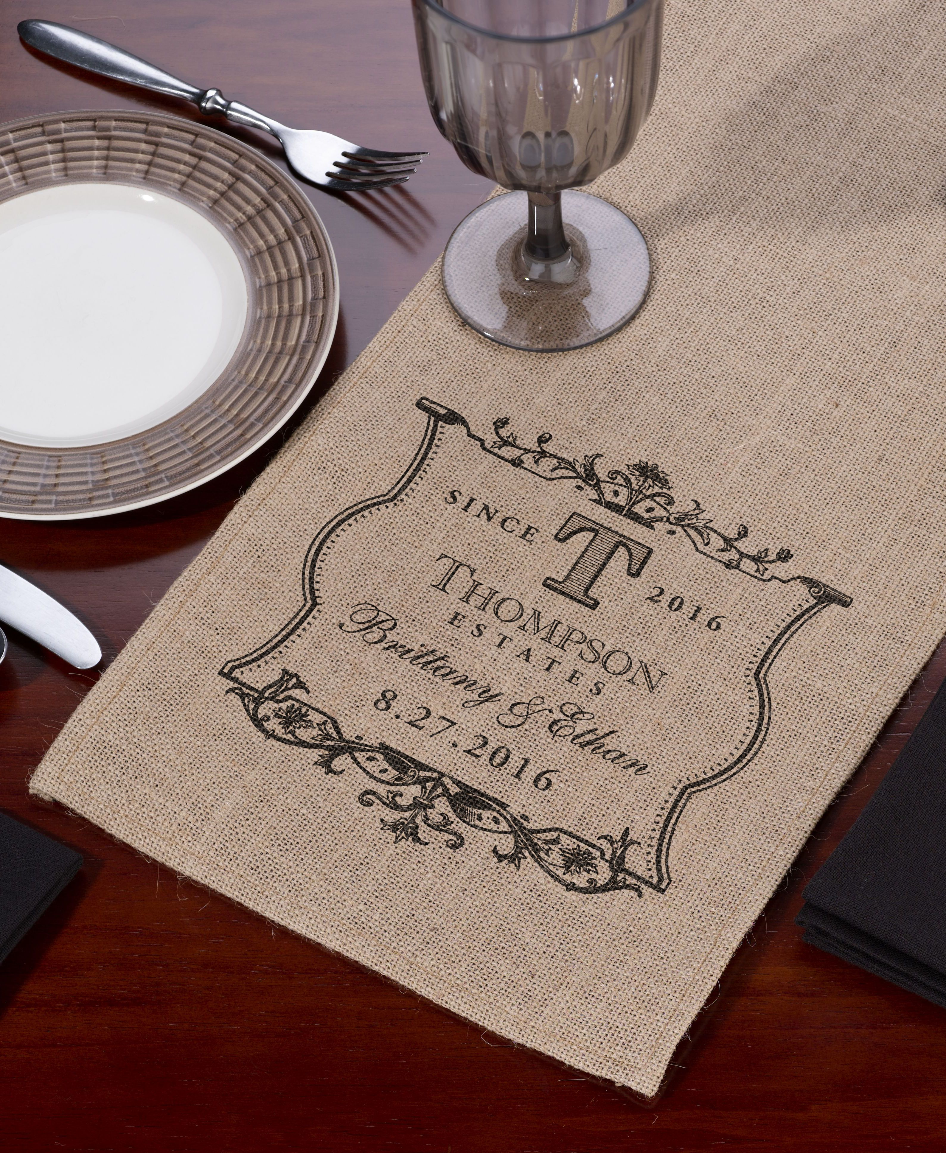What a fun way to personalize your reception!  This burlap table runner is the perfect finishing touch to your wedding reception décor.