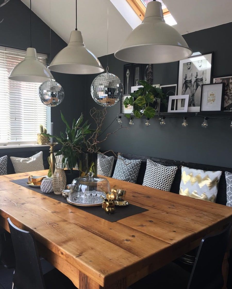 Modern kitchen with dark walls and picture on a shelf with glitters