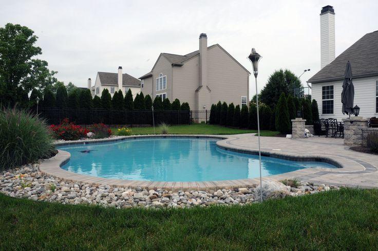 Pool with river rock and pavers backyard pool garden for Backyard inground pool designs