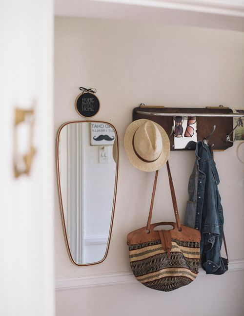 "Sneak Peek: Travis & Maike McNeill. ""I found the coat rack at a flea market in Germany about 5 years ago – it's the kind they used on the trains back in the day. The mirror is another flea-market find :)"" #sneakpeek"
