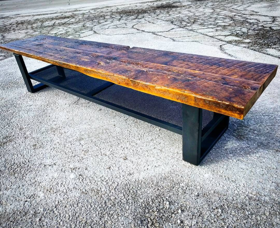 Reclaimed barn board bench with custom steel and mesh frame by barnboardstore.com.  This is a rustic industrial looking piece that is finished with a satin clear coat on the wood and the metal is powder coated flat black.