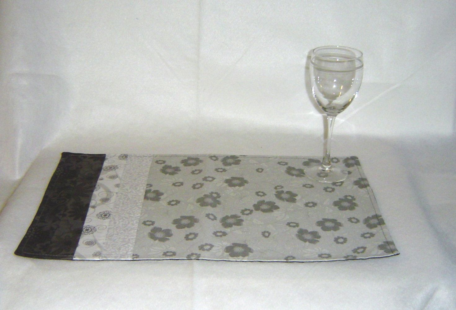 Black white grey placemats art deco style cotton placemats reversible. $40.00, via Etsy.