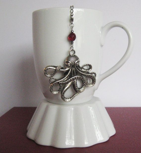 Silver Octopus Tea Ball Charm with Blood Red Bead... The charm attaches to a stainless steel mesh tea ball, and for your convenience, you can