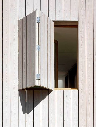 White stained larch cladding hampstead beach house by for What is window cladding
