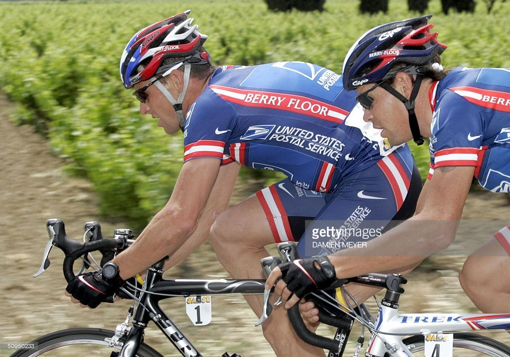 US Lance Armstrong (Team US Postal) (L) pedals with teammate Russian Viatcheslav Ekimov (R) during the fifth stage of the '56th Criterium du Dauhine Libere', between Bollene and Sisteron, 11 June 2004. Australian Stuart O'Grady (Team Cofidis/Fra) won the stage prior to US George Hincapie (Team US Postal) and compatriot Baden Cooke (FDJeux.com/Fra) Spanish Iban Mayo (Team Euskatel/Spa) remains the overall leader.