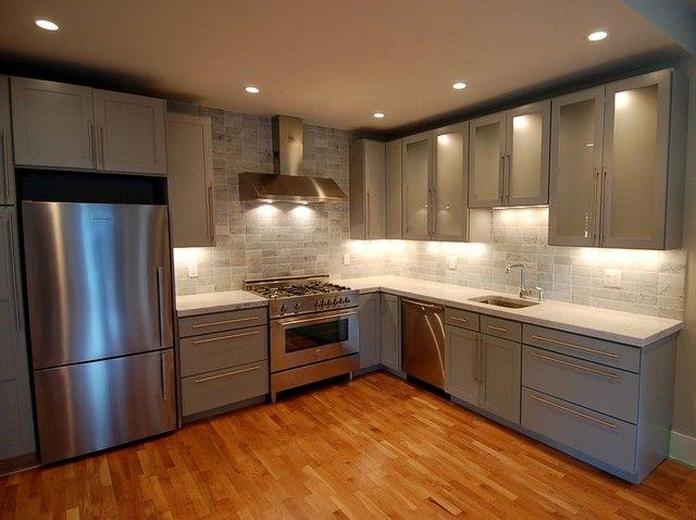 Streamlined tile. Transitional kitchens often interpret ...