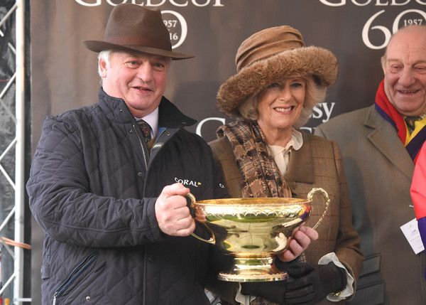 Camilla Parker Bowles Photos Photos - Camilla, Duchess of Cornwall presents a trophy to the winning team of the 60th Hennessy Gold Cup at Newbury Racecourse on November 26, 2016 in Newbury, England. - The Duchess of Cornwall Attends the 60th Hennessy Gold Cup