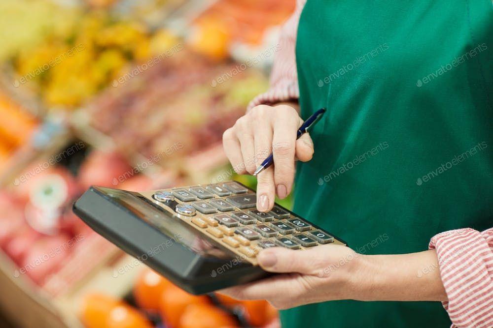 Unrecognizable Shop Owner Calculating Profit By seventyfourimages鈥檚 photos