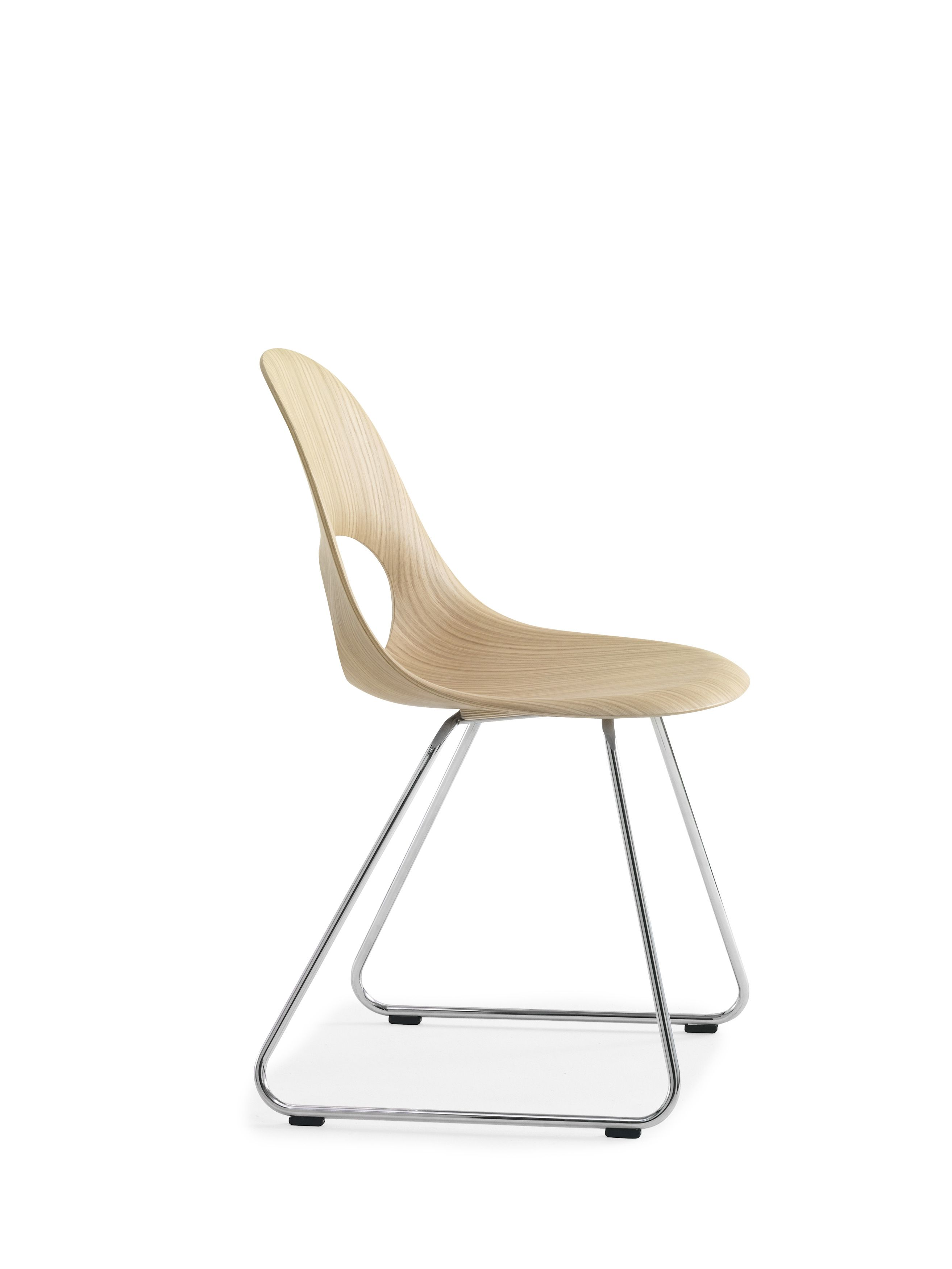 This SayO MiniLux Chair in raw wood with metal legs. May be acquired with different types of wood veneer. Find out more at www.sayo.dk.