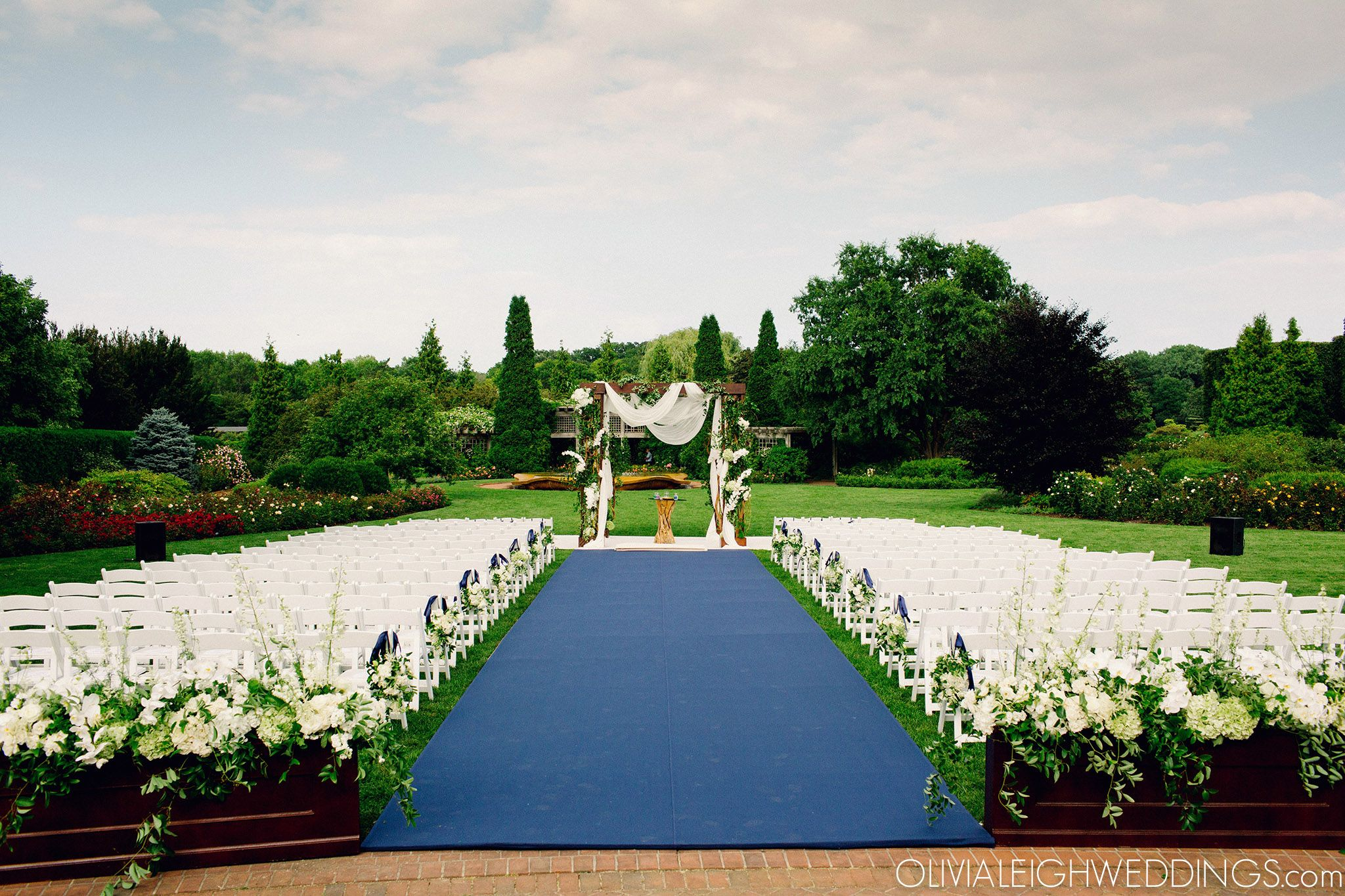 it's a beautiful day for a wedding in the rose garden at the