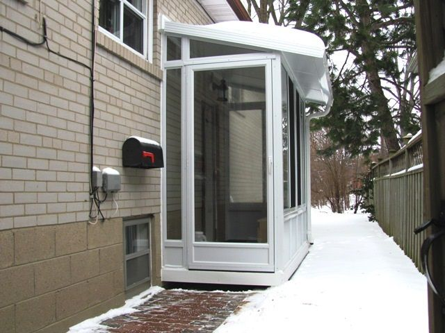 Side Door Enclosure Used As A Vestibule To A Home Office