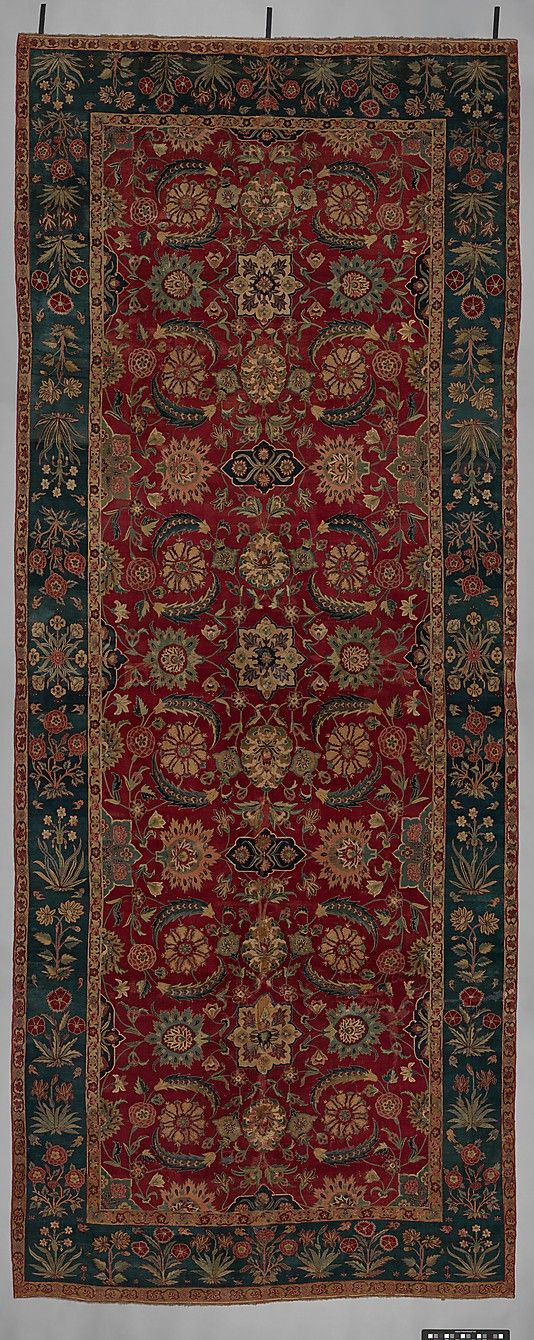 Carpet with Scrolling Vines and Blossoms Object Name: Carpet Date: ca. 1650 Geography: Northern India or Pakistan, Kashmir or Lahore Culture: Islamic Medium: Silk (warp and weft), pashmina wool (pile); asymmetrically knotted pile Dimensions: L. 163 3/4 in. (415.9 cm) W. 66 in. (167.6 cm) Diam. of tube 10 in. (25.4 cm) Accession Number: 14.40.725 Metropolitan Museum of Art