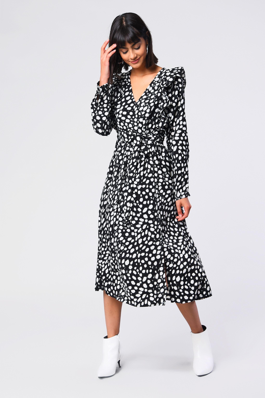 Black stretch spot long sleeve ruffle trim dress trend
