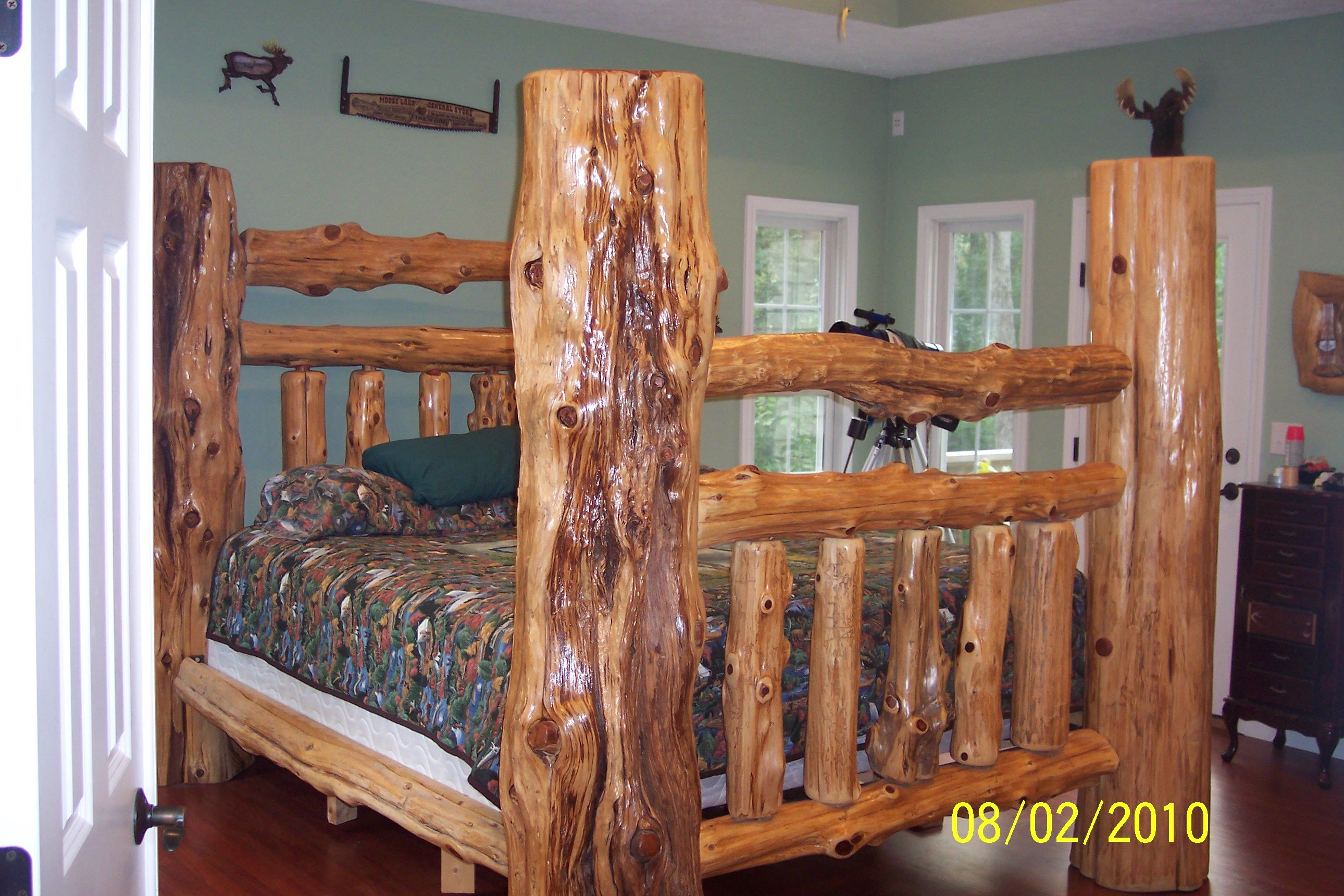 My king sized white cedar log bed, one of a kind Log