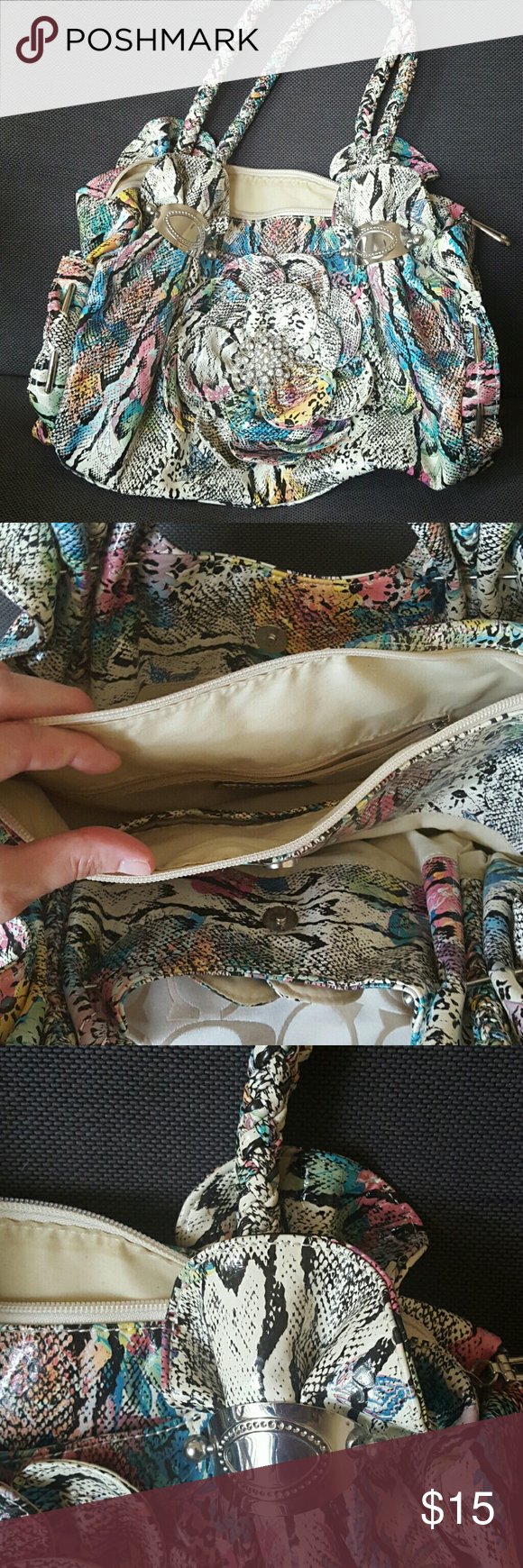 Malti colored purse Large flower on front with gems, front and back pockets, zipper pocket inside, outside zip, and 2 inside pockets open inside gently used *perfect condition* Charming Charlie Bags Shoulder Bags
