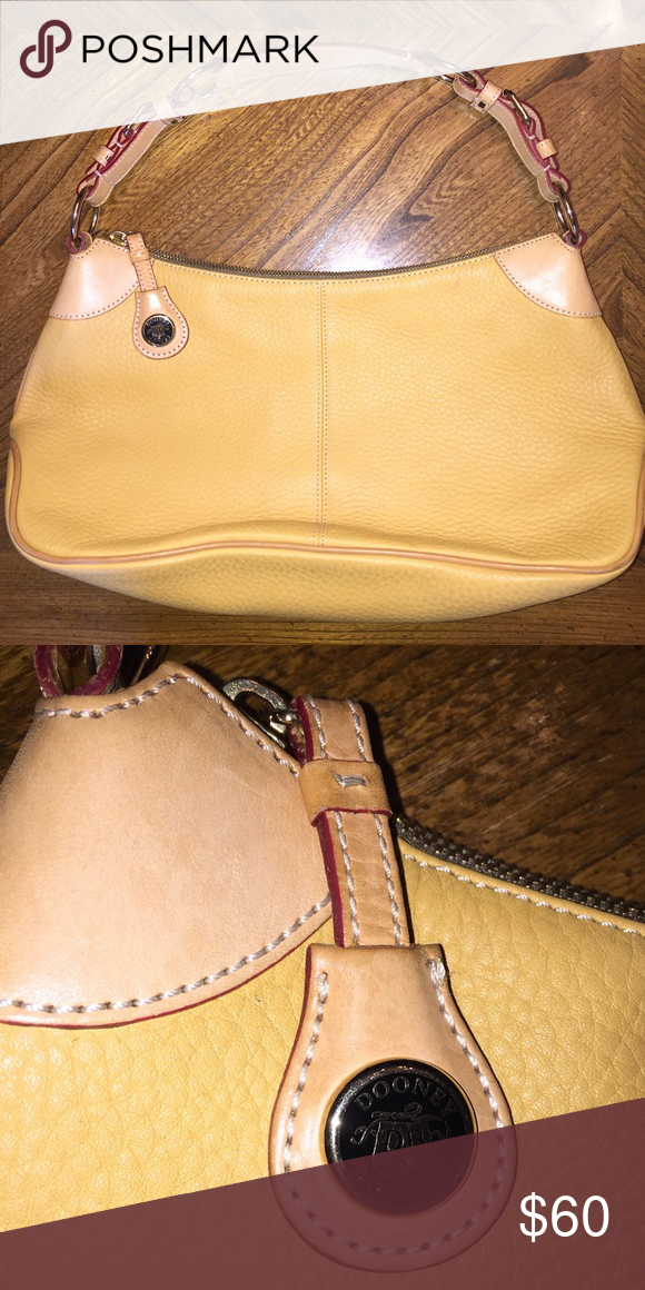 Dooney and Bourke leather purse Yellow leather purse, very cute, minor stains. Will post more photos if interested Dooney & Bourke Bags Satchels