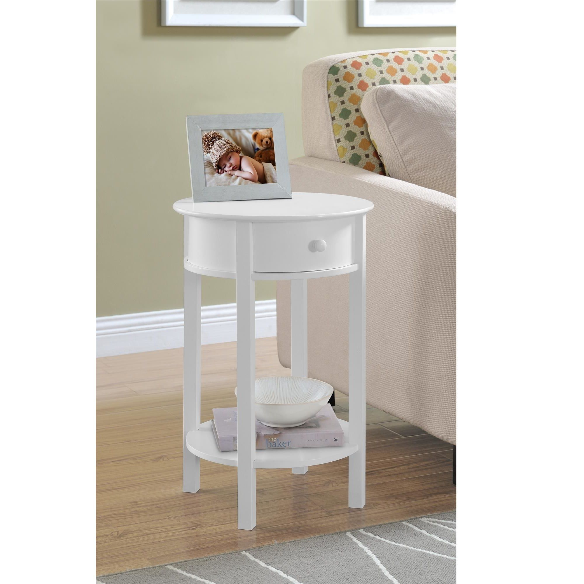 The Altra Furniture Round End Table Features A Small Drawer And Lower Shelf For Storage Is Designed In Beautiful Painted White Finish To Enhance Your