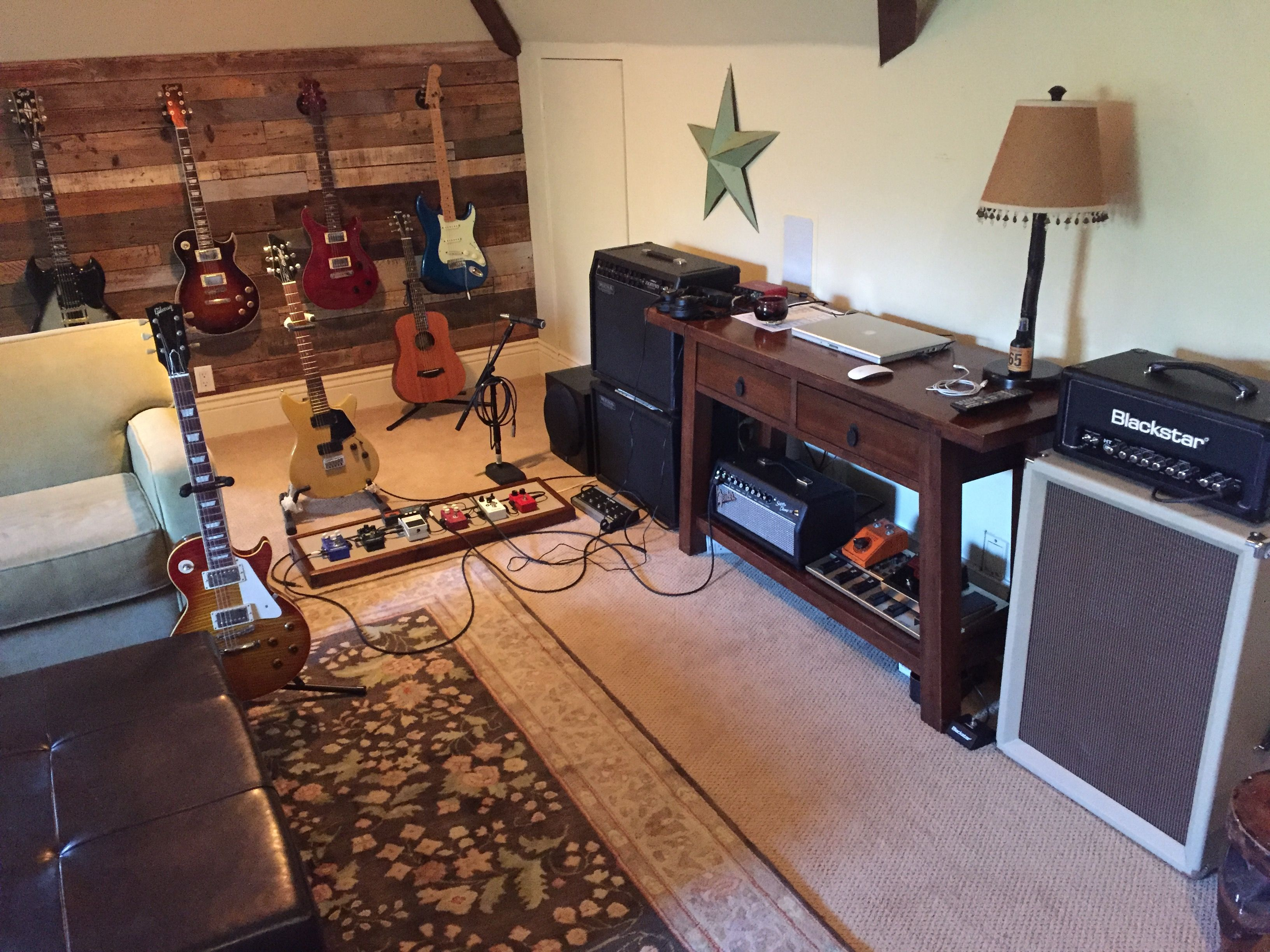 My man cave. Just need to buy more guitars, amps, and pedals.