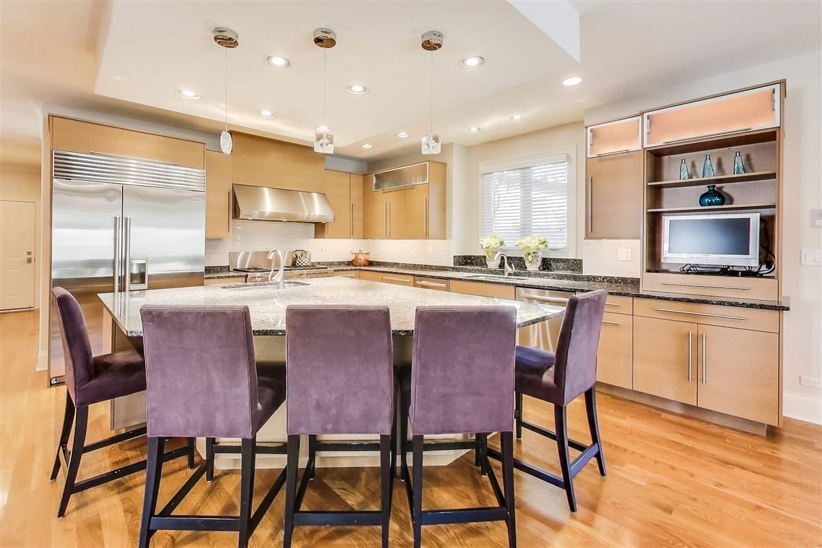 How Do You Like These Blonde Cabinets Pie Shaped Island Design With Lavender Accent Stools Coastal Virgi Kitchen Remodel Kitchen Design Remodeling Magazine