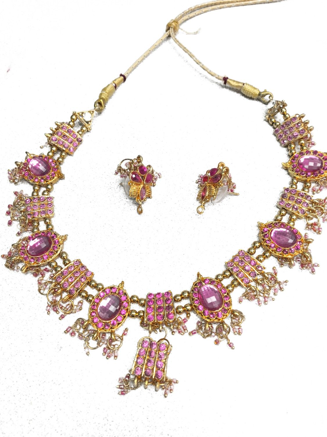 Pink kundan stone necklace set with pink and white stone pendant and