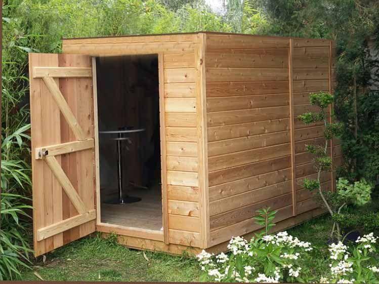 abri de jardin en bois a toit plat sans