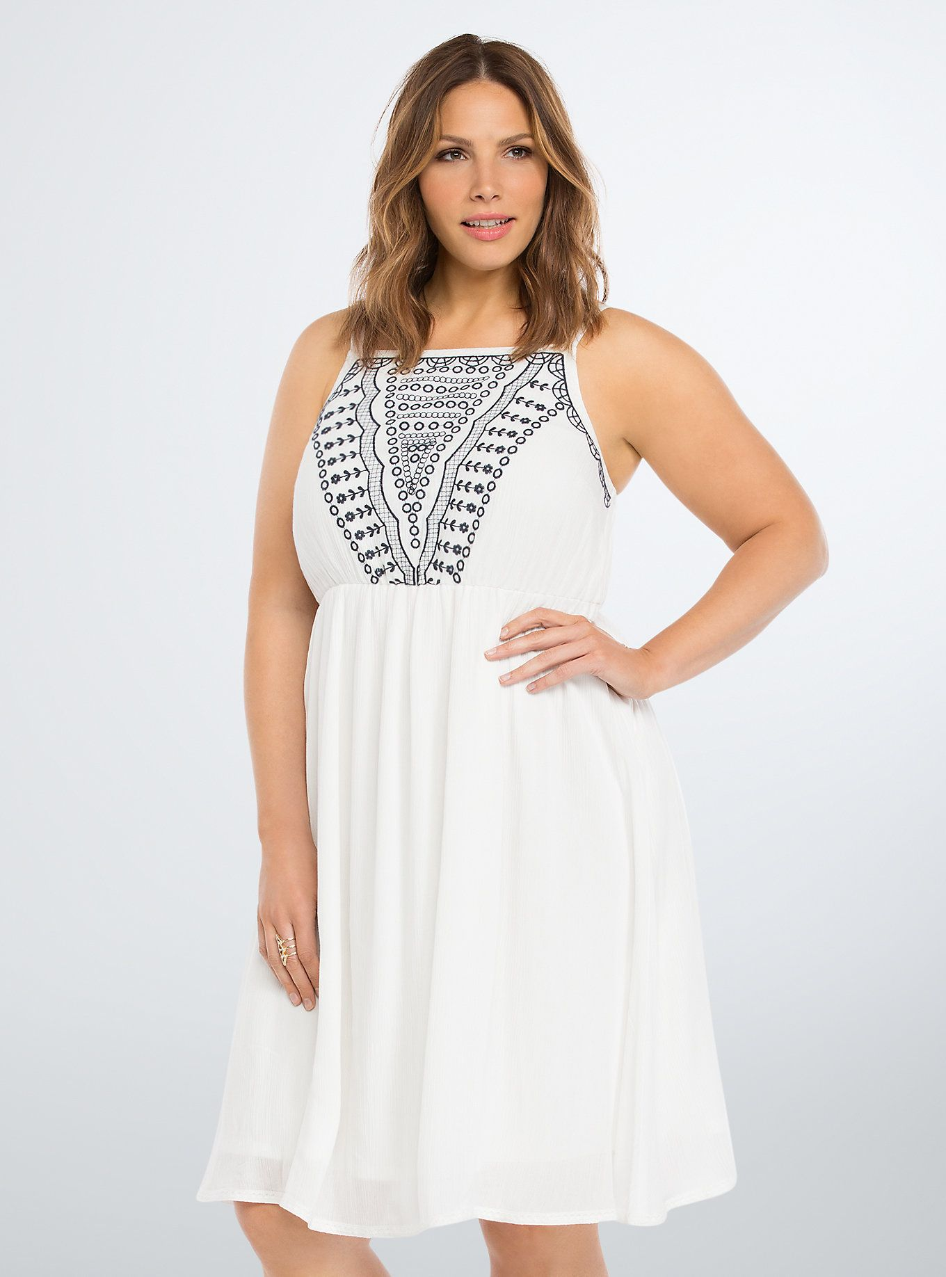 a03b71f2c3d The white hot gauze competes with the summer sun with a midi length.  Gorgeous navy floral embroidery is a sweet topper to the summery stunner.